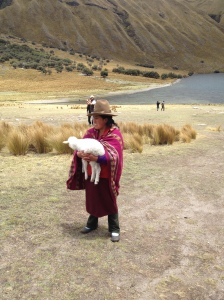Indigenous woman trying to sell pictures with her sheep ;)